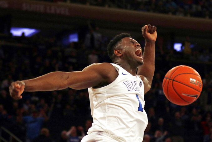 File- This Dec. 20, 2018, file photo shows Duke forward Zion Williamson (1) dunking the ball against Texas Tech during the first half of an NCAA college basketball game in New York.  Williamson  is one of the names you may not know now but very well could by the end of 2019. They figure to come up big in the new year.(AP Photo/Adam Hunger, File)