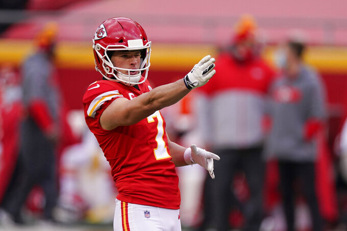 Kansas City Chiefs place kicker Harrison Butker lines up a field goal during the first half of an NFL divisional round football game against the Cleveland Browns, Sunday, Jan. 17, 2021, in Kansas City. (AP Photo/Charlie Riedel)