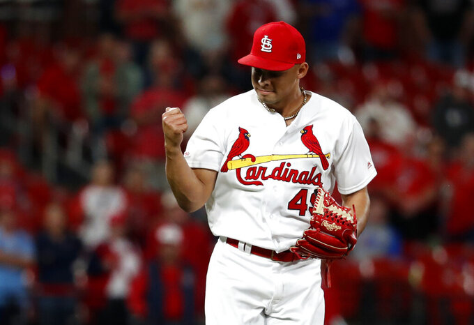 St. Louis Cardinals relief pitcher Jordan Hicks celebrates after striking out Philadelphia Phillies' Rhys Hoskins for the final out of a baseball game Monday, May 6, 2019, in St. Louis. (AP Photo/Jeff Roberson)
