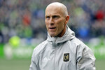FILE - In this March 4, 2018, file photo Los Angeles head coach Bob Bradley walks across the pitch before an MLS soccer match against the Seattle Sounders in Seattle. Bradley was named MLS' Coach of the Year for the third time this week. (AP Photo/Ted S. Warren, File)