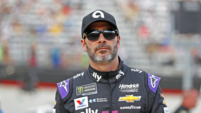 Driver Jimmie Johnson walks to his car before a NASCAR Cup Series auto race, Saturday, Aug. 17, 2019, in Bristol, Tenn. (AP Photo/Wade Payne)