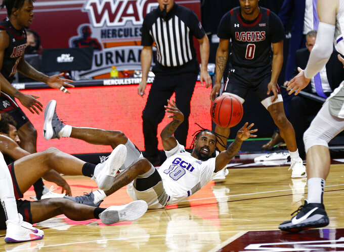 Grand Canyon's Jovan Blacksher Jr. (10) passes the ball during the first half of the team's NCAA college basketball game against New Mexico State for the championship of the Western Athletic Conference men's tournament Saturday, March 13, 2021, in Las Vegas. (AP Photo/Chase Stevens)