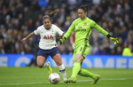 Tottenham Hotspur's Kit Graham, left, and Arsenal's goalie Manuela Zinsberger in action during their Women's Super League soccer match at the Tottenham Hotspur Stadium in London, Sunday Nov. 17, 2019.  The match drew a record crowd of 38,262 for the competition on Sunday when Arsenal claimed a 2-0 victory at Tottenham. (Zac Goodwin/PA via AP)