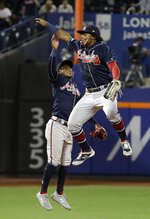 Atlanta Braves' Ozzie Albies, left, celebrates with Ronald Acuna Jr. after a baseball game against the New York Mets, Friday, June 28, 2019, in New York. (AP Photo/Frank Franklin II)