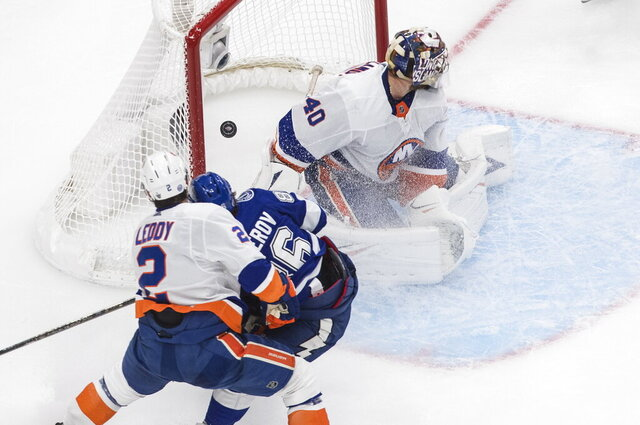 Tampa Bay Lightning's Nikita Kucherov (86) scores against New York Islanders goalie Semyon Varlamov (40) as Islanders' Nick Leddy (2) defends during third-period NHL Eastern Conference final playoff game action in Edmonton, Alberta, Monday, Sept. 7, 2020. (Jason Franson/The Canadian Press via AP)