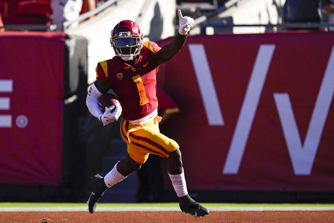 Southern California safety Greg Johnson (1) runs to the end zone for a touchdown after intercepting a pass during the second half of an NCAA college football game against the San Jose State Saturday, Sept. 4, 2021, in Los Angeles. (AP Photo/Ashley Landis)