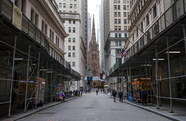 FILE - In this Monday, March 16, 2020, file photo, pedestrian traffic is light along Wall Street in Lower Manhattan in New York. The banking system is not as risk of failing as banks have plenty of capital on hand to handle this crisis due to the new coronavirus, economists say. (AP Photo/Craig Ruttle, File)