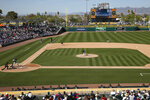 Oakland Athletics' Joakim Soria delivers a pitch to Los Angeles Dodgers Devin Mann in the sixth inning of a spring training baseball game, Thursday, March 5, 2020, in Mesa, Ariz. (AP Photo/Sue Ogrocki)