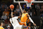 Vanderbilt guard Jordan Wright (4) drives against Tennessee guard Jordan Bowden (23) during the first half of an NCAA college basketball game Saturday, Jan. 18, 2020, in Nashville, Tenn. (AP Photo/Mark Humphrey)
