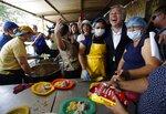 Organization of American States Secretary-General Luis Almagro greets Venezuelan migrants at the
