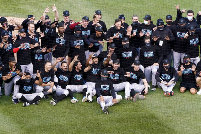 Members of the Miami Marlins celebrate after defeating the Chicago Cubs in Game 2 of a National League wild-card baseball series Friday, Oct. 2, 2020, in Chicago. The Marlins won the series 2-0 to advance to the division series. (AP Photo/Nam Y. Huh)