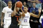 Oregon State guard Ethan Thompson (5) looks to pass around Washington forward RaeQuan Battle (21) during the first half of an NCAA college basketball game Thursday, Jan. 16, 2020, in Seattle. (AP Photo/Ted S. Warren)