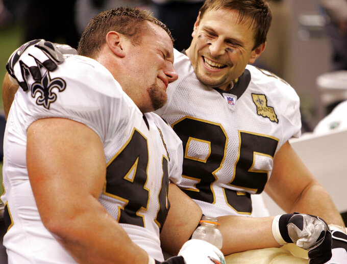 FILE - In this Sept;. 25, 2006, file photo, New Orleans Saints fullback Mike Karney, left, is consoled by teammate Ernie Conwell as he weeps at the end of a 23-3 win over the Atlanta Falcons at the newly re-opened Louisiana Superdome in New Orleans. This one couldn't have been scripted any better for a team that spent all of last season on the road, and it couldn't have come at a better time for a city that is still struggling to overcome the devastation of Hurricane Katrina. (AP Photo/Alex Brandon)