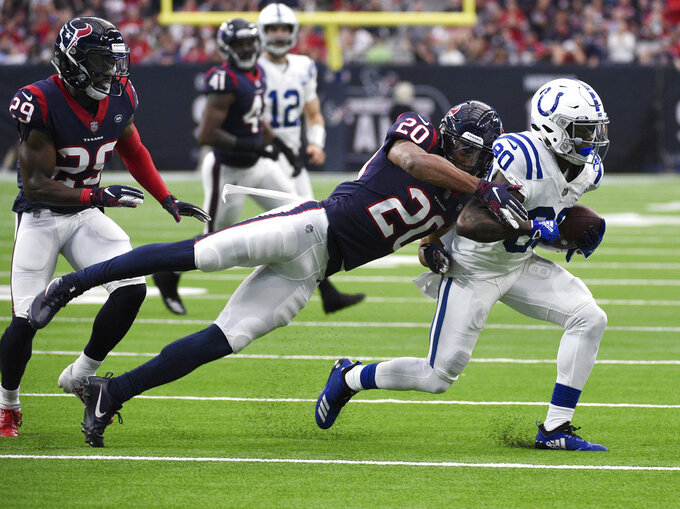 Indianapolis Colts wide receiver Chester Rogers (80) is hit by Houston Texans strong safety Justin Reid (20) after making a catch during the first half of an NFL wild card playoff football game, Saturday, Jan. 5, 2019, in Houston. (AP Photo/Eric Christian Smith)