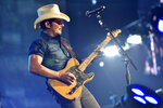 """FILE - This Feb. 24, 2018 file photo shows Brad Paisley performing in Rosemont, Ill.  Paisley will perform in Live Nation's """"Live from the Drive-In,"""" concert series taking place July 10-12.  (Photo by Rob Grabowski/Invision/AP, File)"""