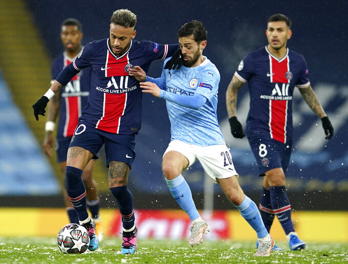 Manchester City's Bernardo Silva, center, challenges PSG's Neymar during the Champions League semifinal second leg soccer match between Manchester City and Paris Saint Germain at the Etihad stadium, in Manchester, Tuesday, May 4, 2021. (AP Photo/Dave Thompson)