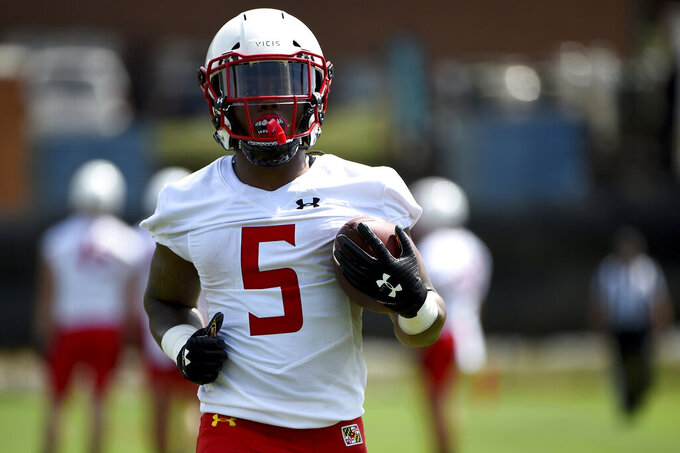 FILE - In this Aug. 2, 2019, file photo, Maryland running back Anthony McFarland works out during an NCAA college football training camp in College Park, Md. Coming off the darkest season in the history of the Maryland football program, the Terrapins are poised to enter a new era under Mike Locksley, hired in December after a successful run as Alabama's offensive coordinator, who remembers what it was like when the team competed for conference titles and counted on playing in bowl games. (AP Photo/Will Newton, File)