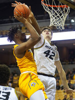 Missouri's Parker Braun, right, blocks the shot of Morehead State's Tyzhaun Claude, left, during the first half of an NCAA college basketball game Wednesday, Nov. 20, 2019, in Columbia, Mo. (AP Photo/L.G. Patterson)