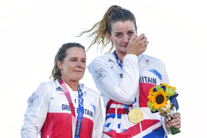 Great Britain's Hanna Mills and Eilidh Mcintyre celebrate the 470 women's gold medal during the 2020 Summer Olympics, Wednesday, Aug. 4, 2021, in Fujisawa, Japan. (AP Photo/Gregorio Borgia)