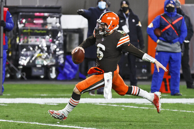 Cleveland Browns quarterback Baker Mayfield rushes for a 5-yard touchdown during the second half of an NFL football game against the Baltimore Ravens, Monday, Dec. 14, 2020, in Cleveland. (AP Photo/Ron Schwane)
