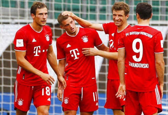 Munich's scorer Mickael Cuisance, second left, and his teammates celebrate their side's second goal   during the German Bundesliga soccer match between VfL Wolfsburg and FC Bayern Munich in Wolfsburg, Germany, Saturday, June 27, 2020. (Kai Pfaffenbach/Pool Photo via AP)