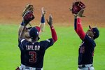 Washington Nationals' Gerardo Parra, Michael A. Taylor and Juan Soto celebrate after Game 2 of the baseball World Series against the Houston Astros Thursday, Oct. 24, 2019, in Houston. The Nationals won 12-3 to take a 2-0 lead in the series. (AP Photo/Eric Gay)