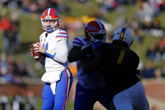 Florida quarterback Kyle Trask looks to pass during the second half of an NCAA college football game against Missouri, Saturday, Nov. 16, 2019, in Columbia, Mo. Florida won 23-6. (AP Photo/Jeff Roberson)