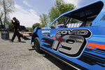 Gabe Wilkins walks away from his car at Gas City I-69 Speedway, Sunday, May 24, 2020, in Gas City, Ind. (AP Photo/Darron Cummings)