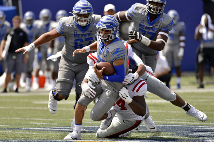 Memphis quarterback Brady White (3) is tackled in the second half of an NCAA college football game against Mississippi, Saturday, Aug. 31, 2019, in Memphis, Tenn. (AP Photo/Brandon Dill)