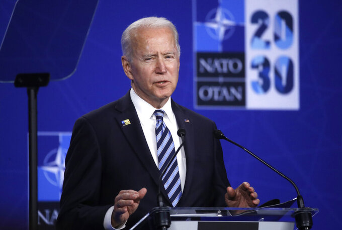 """U.S. President Joe Biden speaks during a media conference during a NATO summit in Brussels, Monday, June 14, 2021. The Chinese mission to the European Union on Tuesday denounced a NATO statement that declared Beijing a """"security challenge,"""" saying China is actually a force for peace but will defend itself if threatened. (Olivier Hoslet, Pool via AP)"""