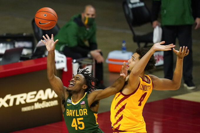 Baylor guard Davion Mitchell (45) is fouled by Iowa State forward George Conditt IV while driving to the basket during the second half of an NCAA college basketball game, Saturday, Jan. 2, 2021, in Ames, Iowa. Baylor won 76-65. (AP Photo/Charlie Neibergall)