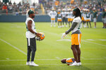 FILE - Green Bay Packers' wide receiver Randall Cobb (18) and wide receiver Davante Adams (17) talk during NFL football training camp in Green Bay, Wisc., in this Saturday, July 31, 2021, file photo. Adams says the addition of veteran Randall Cobb has made it easier to provide leadership to the team's younger receivers.(AP Photo/Matt Ludtke, File)
