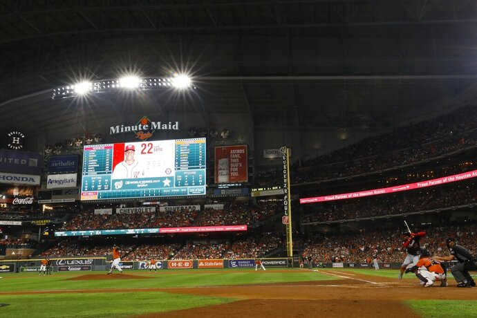 FILE - In this Oct. 30, 2019, file photo, Houston Astros starting pitcher Zack Greinke throws during the second inning of Game 7 of the baseball World Series against the Washington Nationals in Houston. The higher seeded team reaching the World Series will have last at-bats in Games 1 and 2 and if needed Games 6 and 7, not necessarily the team with the best record. The specification was contained in the July 23, 2020, agreement between Major League Baseball and the players' association to expand the playoffs following a regular season shortened due to the novel coronavirus. (AP Photo/Matt Slocum, File)