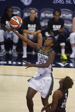 Seattle Storm's Jewell Loyd shoots next to Indiana Fever's Danielle Robinson during the second half of a WNBA basketball game Thursday, June 17, 2021, in Indianapolis. (AP Photo/Darron Cummings)