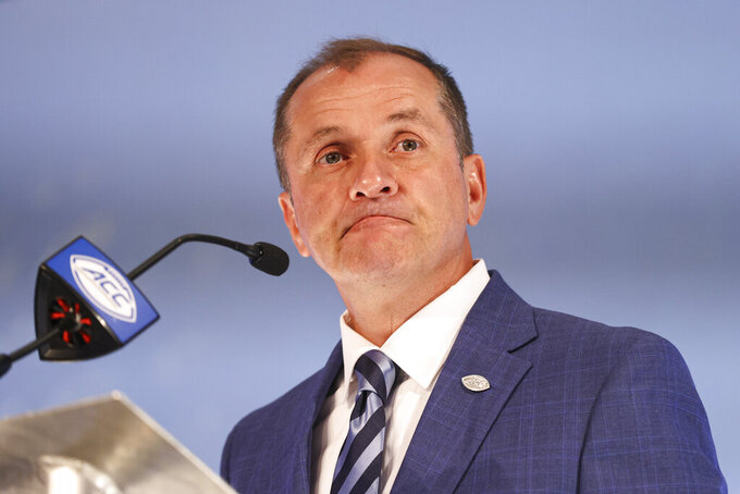 Atlantic Coast Conference commissioner Jim Phillips listens to a question during a press conference at the NCAA college football ACC media days in Charlotte, N.C., Wednesday, July 21, 2021. (AP Photo/Nell Redmond)