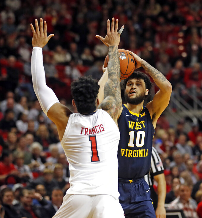 West Virginia's Jermaine Haley (10) shoots the ball over Texas Tech's Brandone Francis (1) during the second half of an NCAA college basketball game, Monday, Feb. 4, 2019, in Lubbock, Texas. (AP Photo/Brad Tollefson)