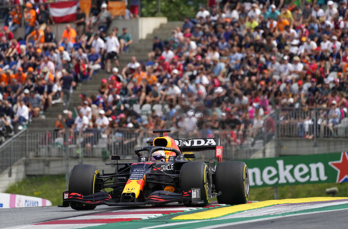 Red Bull driver Max Verstappen of the Netherlands steers his car during the Austrian Formula One Grand Prix at the Red Bull Ring racetrack in Spielberg, Austria, Sunday, July 4, 2021. (AP Photo/Darko Bandic)