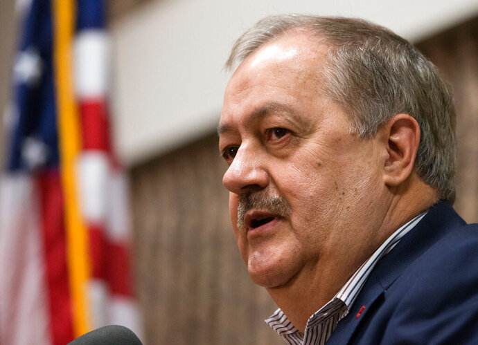 FILE - In this Jan. 18, 2018, file photo, former Massey CEO and West Virginia Republican Senatorial candidate, Don Blankenship, speaks during a town hall to kick off his campaign in Logan, W.Va. Blankenship is suing several news outlets and media personalities, claiming he was defamed during his failed bid for a U.S. senate seat in West Virginia. Blankenship's suit was filed Thursday, March 14, 2019 in Mingo County, West Virginia. (AP Photo/Steve Helber, File)