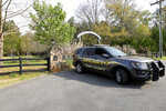 A York County sheriff's deputy is parked outside a residence where multiple people, including a prominent doctor, were fatally shot a day earlier, Thursday, April 8, 2021, in Rock Hill, S.C. A source briefed on the mass killing said the gunman was former NFL player Phillip Adams, who shot himself to death early Thursday. (AP Photo/Nell Redmond)
