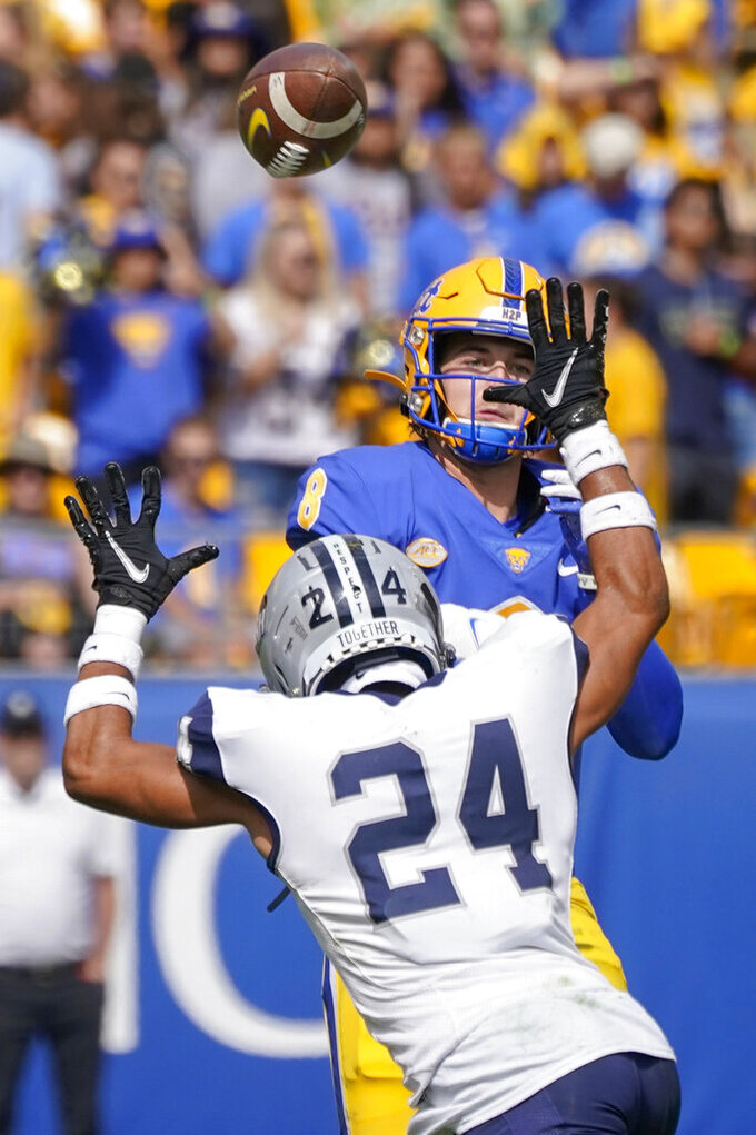 Pittsburgh quarterback Kenny Pickett (8), top, gets off a pass as New Hampshire defensive back Caleb Mead (24) pressures during the first half of an NCAA college football game, Saturday, Sept. 25, 2021, in Pittsburgh. (AP Photo/Keith Srakocic)