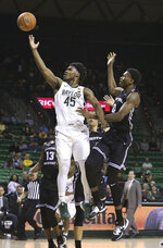 Baylor guard Davion Mitchell (45) attempts a shot against Central Arkansas forward Sk Shittu (0) in the second half of an NCAA college basketball game Tuesday, Nov. 5, 2019, in Waco, Texas. (AP photo/ Jerry Larson)