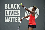 Venus Williams prepares to serve to her sister Serena Williams during the WTA tennis tournament in Nicholasville, Ky., Thursday, Aug. 13, 2020. (AP Photo/Timothy D. Easley)