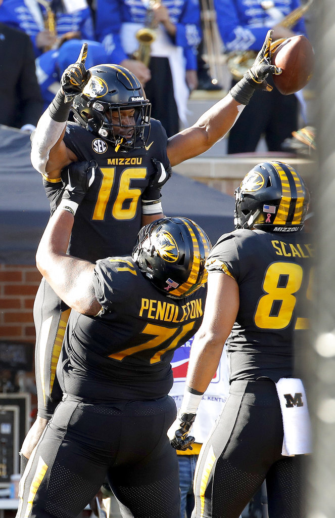 Missouri running back Damarea Crockett (16) celebrates with offensive lineman Kevin Pendleton (71) after scoring a touchdown during the first half of an NCAA college football game against Kentucky Saturday, Oct. 27, 2018, in Columbia, Mo. (AP Photo/Charlie Riedel)