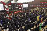 Indonesian parliament members read their oath during their swearing-in ceremony in Jakarta, Indonesia, Tuesday, Oct. 1, 2019. Indonesia's Parliament was sworn in Tuesday for a new session that comes amid sometimes violent protests against several new or proposed laws, including one that critics say has crippled the country's anti-corruption agency and another that would criminalize premarital sex. (AP Photo/Mario Jose)
