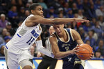 George Washington's Armel Potter (2) heads to the basket as Saint Louis' Demarius Jacobs (15) defends during the first half of an NCAA college basketball game Wednesday, Jan. 8, 2020, in St. Louis. (AP Photo/Jeff Roberson)