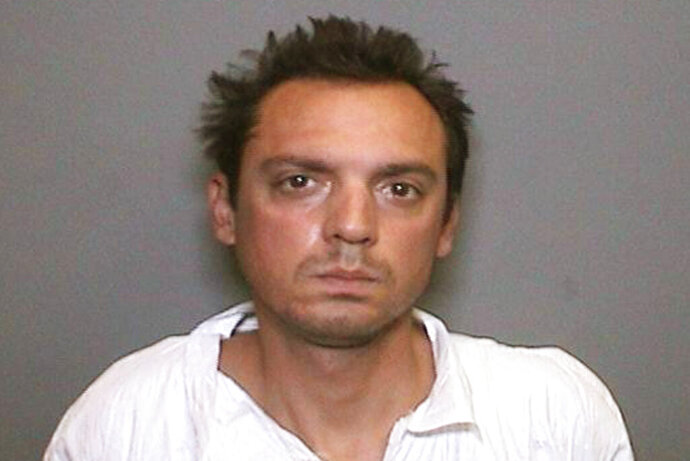This undated booking photo provided by the Orange County District Attorney's Office shows Dennis Thomas Monson Jr. Monson, the suspect in the stabbing death of a man on a Southern California bike trail three years ago, has been found mentally unfit to stand trial. A judge ordered that Monson be committed to a state hospital for mental health treatment. The judge's ruling essentially places Monson's murder case on hold until it is determined he is able to understand the charges he is facing and assist with his own defense. (Orange County District Attorney's Office via AP)