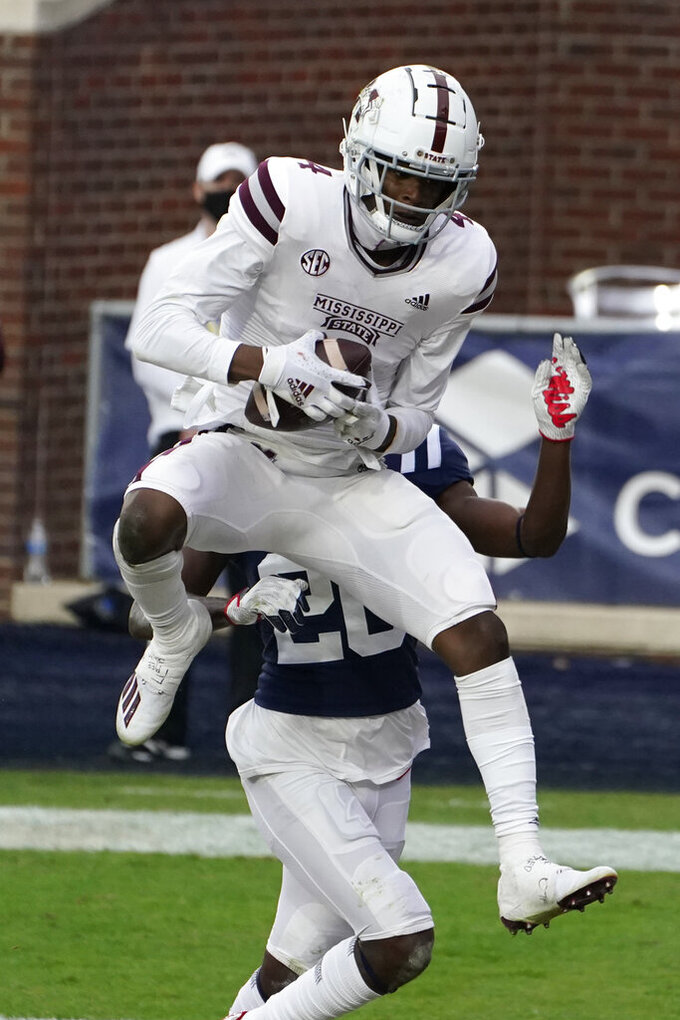 Mississippi State wide receiver Malik Heath (4) catches a touchdown pass during the first half of an NCAA college football game against Mississippi, Saturday, Nov. 28, 2020, in Oxford, Miss. (AP Photo/Rogelio V. Solis)