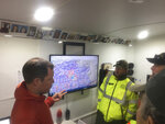 This April 17, 2017, photo provided by Michael St. John shows search and rescue volunteer and SARTopo creator Matt Jacobs, left, and search and rescue volunteers Mike Russo, center, and Bob Gehlen, right, in Sierraville, California, as they consult a SARTopo map while making plans to search for a missing aircraft. The dramatic rescue of a hiker lost for more than two weeks in a remote Hawaii forest is showing how emerging technology is helping search teams more efficiently scour the wilderness for missing people. (Michael St. John/Marin County Sheriff's SAR unit via AP)