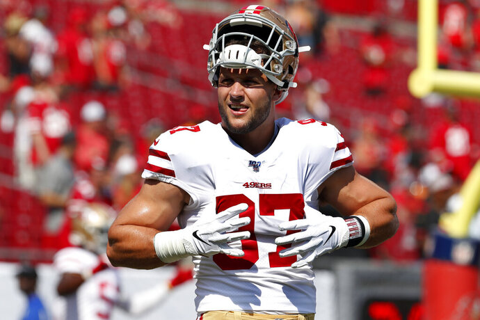 FILE - In this Sunday, Sept. 8, 2019, file photo, San Francisco 49ers defensive end Nick Bosa (97) warms up before an NFL football game against the Tampa Bay Buccaneers in Tampa, Fla. The rookie defensive end is not practicing as the 49ers began three days of workouts at Youngstown State. The No. 2 overall pick from Ohio State missed the entire preseason with a high ankle sprain, but played 39 total snaps and had a sack Sunday in San Francisco's 31-17 win at Tampa Bay. (AP Photo/Mark LoMoglio, File)
