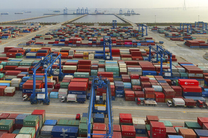 FILE - In this April 8, 2021 file photo, a container port on the Yangtze River is seen in an aerial view in Nantong in eastern China's Jiangsu province. China reported that its April imports and exports surged over the same month in 2020 as global demand strengthens. (Chinatopix via AP, File)